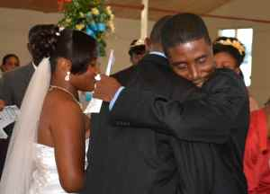 As he prepares to marry Dorothie, Pere Wilky Avril embraces her father during the wedding at St. Trinity Episcopal Cathedral, Port-au-Prince, Haiti, on May 1, 2014.