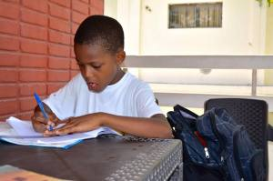 Carlins, 9, hard at it. He spends a lot of time on homework, and his report card proves it!