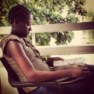 Shinay Dine Geffrard, reading on the balcony of my apartment in Port-au-Prince, July 2013.